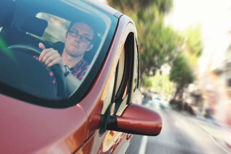Man performing a driving test manoeuvre in his car.