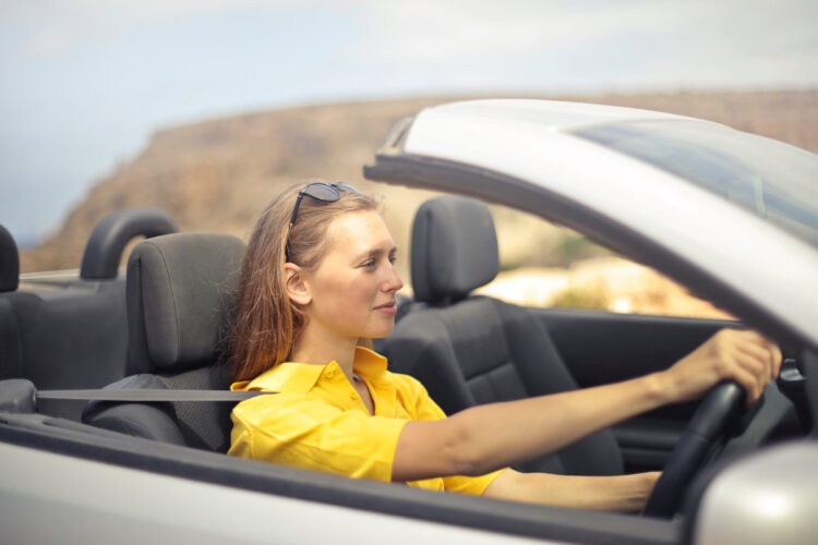 A woman demonstrating safe, independent driving having passed her test.
